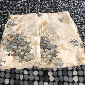 White mini skirt with tan and blue flower design